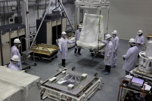 A section of the SAGE 111 project is rolled out of the cleanroom to be encased for shipping.